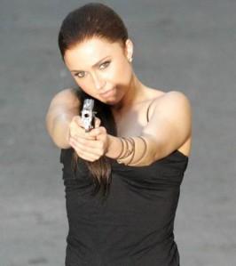 Hayden holding a gun