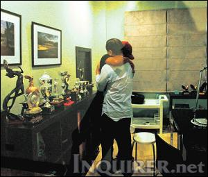 BROADCASTER Ted Failon clings tightly to Vice President Noli de Castro inside his home in Tierra Pura, Quezon City,